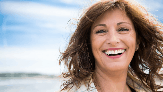 Women with beautiful smile goes to Dentist Salem Oregon- Hunsaker Dental